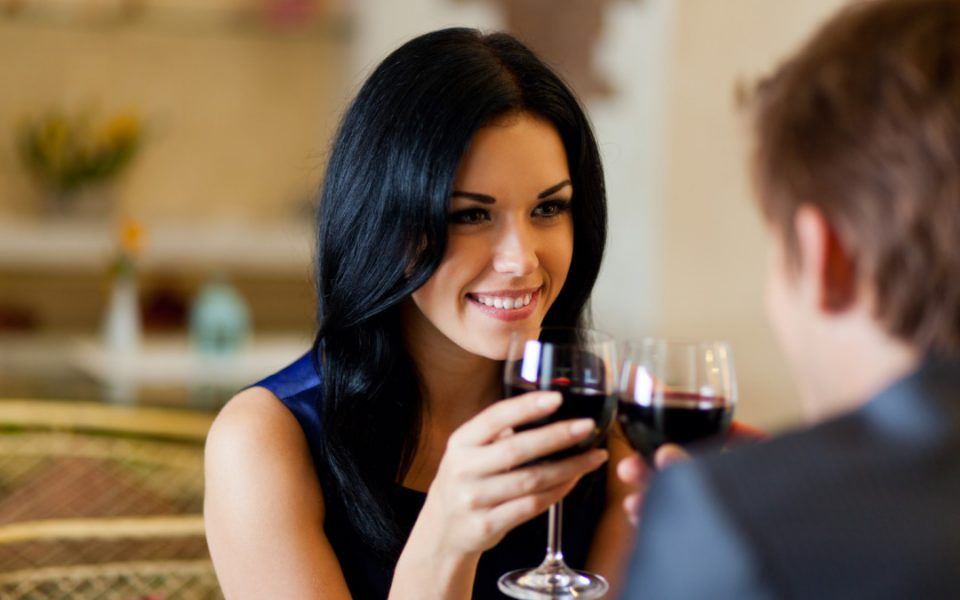 A woman holding a wine glass